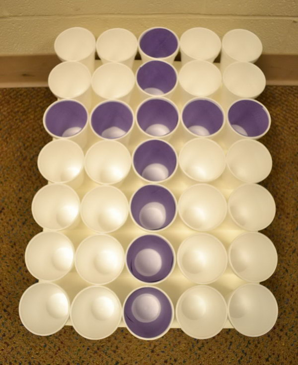 Cross Toss. Prepare all the cups in a tray and insert the rolled purple paper to make a cross. Throw all the purple Easter eggs in the purple cups. The kids will surely have fun and they can also improve their shooting accuracy.