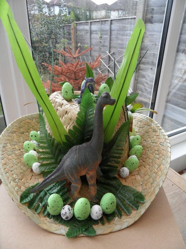 Dinosaur Easter Bonnet. This dinosaur Easter hat is so cool. Buy a large size straw hat, then decorate it with dinosaurs, Easter eggs and leaves, you'll get this amazing art piece.