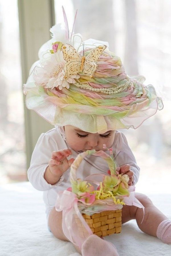Rainbow Sherbet Frilly Easter Hat. This beautiful large frilly hat has a good combination of colors from the rainbow. With decorations of feathers, ribbon, beaded flower butterfly, it turns a little girl into the princess.