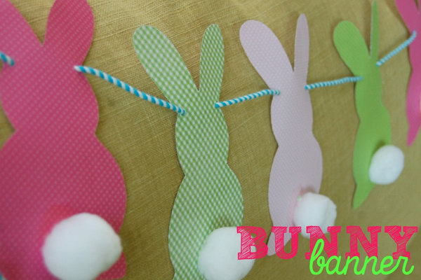 Bunnies on Construction Paper. Glue the pom poms on the colorful bunnies on construction paper and thread them all with a string. You can hang them anywhere as you like, Your kid must like this adorable decoration very much.