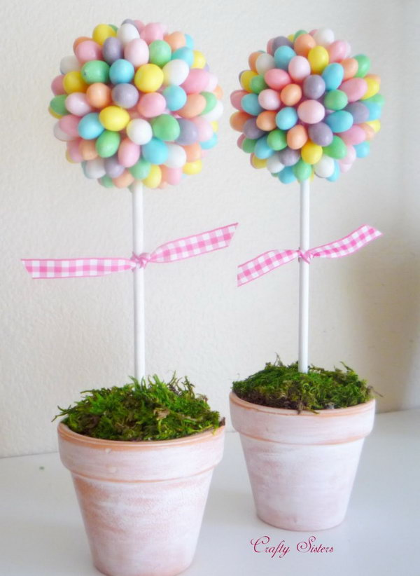 Jelly Bean Topiary. This cute and romance themed jelly bean topiary adds a fresh spring flavor for your Easter decoration. Glue each jelly bean onto a pink Styrofoam ball add floral foam to anchor the dowel into and cover it with moss.