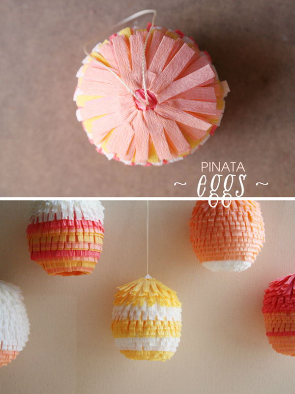 Cute Easter Pinata Eggs. DIY these pi?ata Easter eggs with blown out jumbo chicken eggs, floral crepe paper, thread, glues and toothpicks. They are easy to make and will definitely brighten up your celebration.