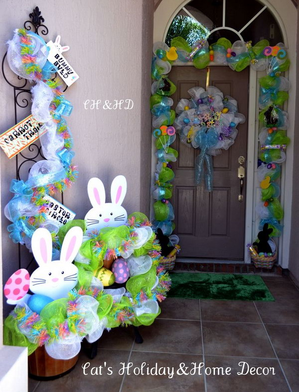 Easter Basket Door Decor. This well refined Easter decor starts with mesh in white and lime green, add the ribbons as the base. Put two baskets filled with treats for children at two sides such as chocolate bunnies, rolled candy, Easter eggs and jelly beans.