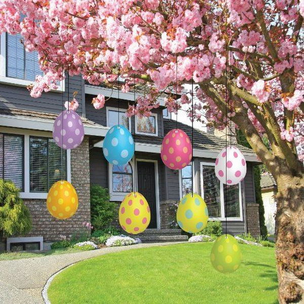 Easter Egg Decoration. Hang Colorful Easter Eggs Under The Branches Of  Beautiful Flower Tree Is