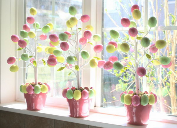Target Dollar Egg Tree. To DIY this beautiful Easter egg tree, all you need is the Easter tree a pot and 2 boxes of foam glitter Easter eggs. These eggs are light-weight, you can pock them onto the branch even without gluing.