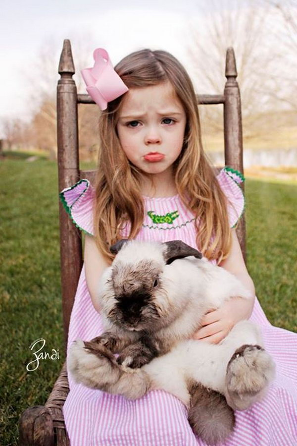 Adorable Easter Picture with Cute Expression. Sitting on a chair, hugging the bunny, whether you smile, laugh, cry or fell angry. Just snap the funny expression. It's interesting to see your funny expression and you may wonder why you feel this way at that moment.