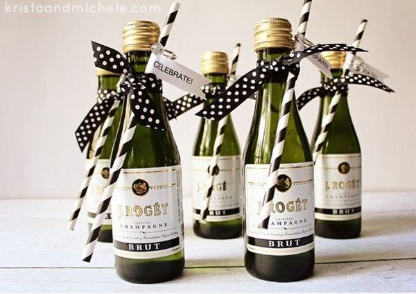 Mini Champagne Bottle Engagement Party Favors. Glue the tag on the straw and hang the confetti ring above the tag. Tie the straw to the Champagne bottle with the polka dot ribbons in a bow. They are so easy to make and perfect for your Engagement Party.