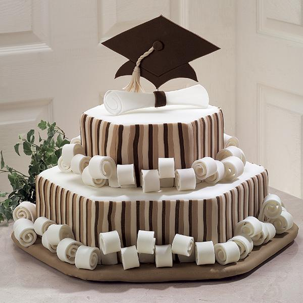 Honor Roll Scroll Graduation Cake. Without too many bright colors, this amazing graduation cake features the big cap at the top, diploma and curls as well as attached side strips in simple colors for a school flavor.