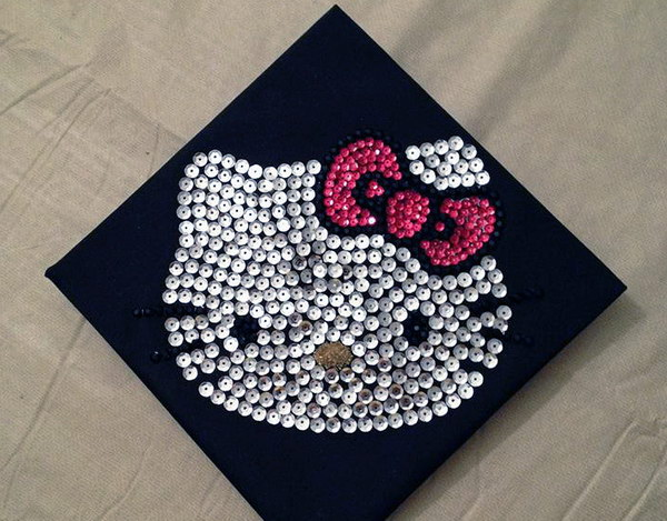Hello Kitty Graduation Cap. Little girls must adore this cute hello kitty graduation cap. Lay out sequins in a hello kitty design and use threads to secure it.