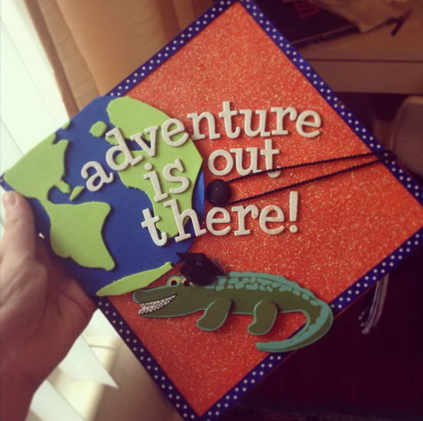 Travel Inspired Graduation Cap. This stunning graduation cap features a crocodile wearing a graduation cap. There is also a part of the globe above it. Start your adventure with this cool cap after graduation.