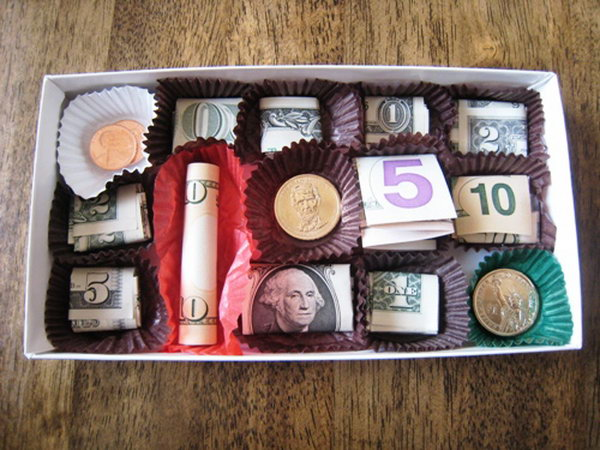 Funny Chocolate Graduation Gift. Unwrap the candy box, nestle within candy papers varied denominations as you like. Adhere the currency to the candy liner to create the sweet chocolate cash box gift to surprise the graduate.
