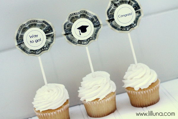 Cash Topped Graduation Cupcake. Fold cash bills into accordions, Glue them on the Popsicle sticks and use glue spot to add those labels. It's time to surprise the graduate with this cash topped graduation cupcake for sweet flavor and emergency need of cash.