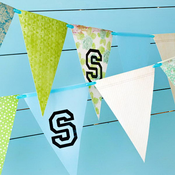 School Spirit  Garland Graduation Decor. Cut paper into triangles, mark up the sign of your school thread them through to create this graduation pennant garland to reflect the spirit of your school and ornament your graduation party.