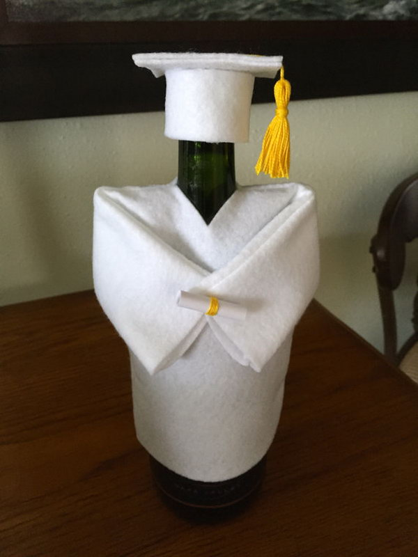 Funny Graduation Decoration. This graduation cap and gown champagne or wine bottle cover is just so fantastic with its funny outlook. It will definitely make the focal point of this graduation party.