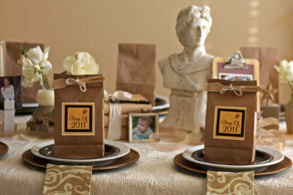 Through the Years Graduation Party. Use natural burlap ribbon wrapped around vases and a scholarly looking bust for the centerpiece decoration. I really adore the neutral color scheme to give the party a casual and reminiscent of school flavor.