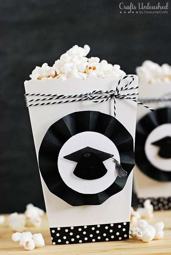 Graduation Party Popcorn Boxes. Embellish the white boxes to coordinate with your party theme. Make the rosettes with a scoring board and black cardstock to finish off the popcorn boxes with a graduation party design.