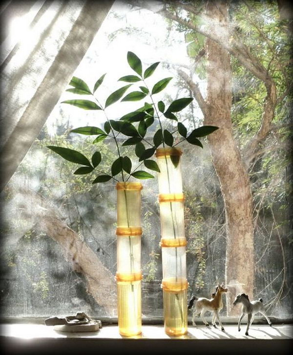 Faux bamboo vases. If you have a massive collection of empty pill bottles, don't discard them. It's a cool idea to create these faux bamboos.
