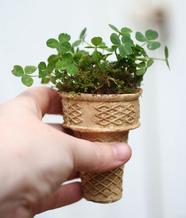 Ice cream cone planter.Plant seeds in ice cream cones and put it on the ground.How clever,It's biodegradable and is the perfect way to start a small garden. http://hative.com/creative-new-uses-for-everyday-items/