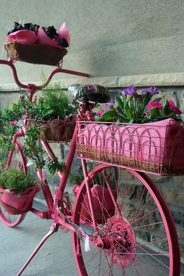 Nowadays, few people use the bicycles as a vehicle and the old or broken bicycles also take up space in your house. Then how to handle them .Here is a good way to reuse the old bicycles to plant some flowers and grasses to decorate your backyard.