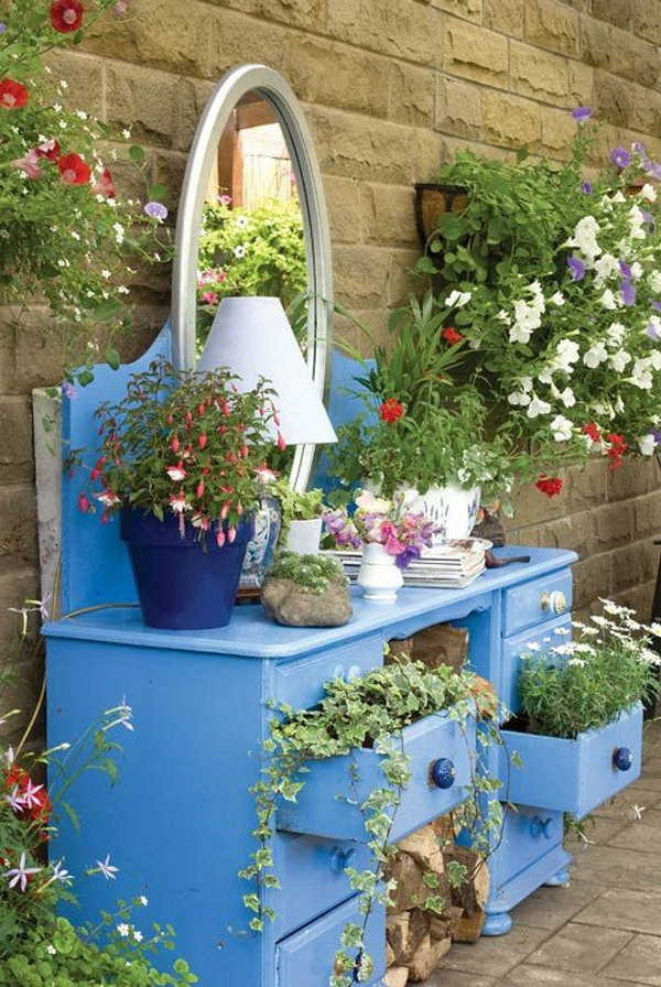 If you have an old dresser, do not just throw it away. You can give it a second life to create a multi level flower bed. Another way, you can also use it to stage pots stones and gardening tools on the top for added interests to make your garden organized and decorate your yard.