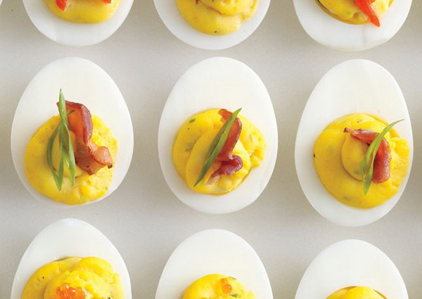 Bacon Deviled Eggs. Drain the boiled eggs, remove yolks, mash reserved yolks, bacon fat, mayonnaise, mustard, scallions and season with salt and pepper for tasty flavor to fill your guests with energy after the exciting party events.