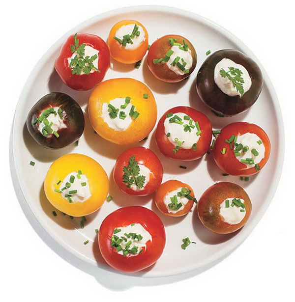 Horseradish Stuffed Cherry Tomatoes. Use small knife to scoop out centers of cherry tomatoes, spike mayonnaise with horseradish. Top it with fresh herbs to present a beautiful outlook. It's super chic to serve your guests with this dinner party food.