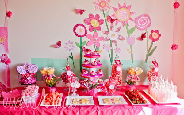 i really appreciate the sweet floral design backdrop the dessert table consists