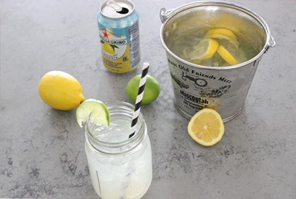 Gin Bucket. Add gin, lemon slices, and lime wheels to the ice bucket. Pour in soda, juice and syrup, distribute gin bucket into your cups filled with ice to finish off the fantastic summer time beverage recipe to whip up your summer time.