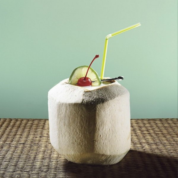Luau Coconut. Serve the guests with something fun to enjoy your summer time party for a fantastic flavor. Cut off the top of coconut, add in ice, shaker contents, garnish with lime slice and maraschino cherry. Serve with straw and spoon for scraping out coconut from the shell to taste the breathtaking flavor.