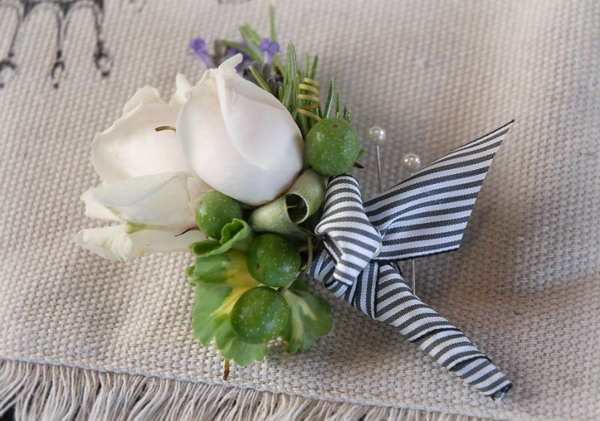 DIY Groom's Boutonniere. Select flowers and foliage to use in your boutonniere. Cover the stem part with floral wire and balance your floral arrangement with floral clippers. Finish it off with ribbon decorations.