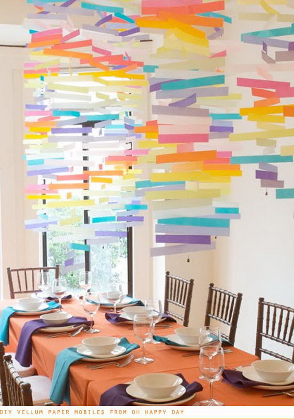 DIY Vellum Paper Mobiles. Use vellum paper and a sewing machine to hang some mobiles for a playful decor detail. This colorful hanging art piece will be bound to impress your wedding ceremony.