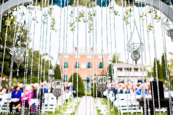 Beaded Curtain. This stunning beaded curtain will bring you to the fairyland. It's super chic to hang up such a beaded curtain for your wedding ceremony where you'll say I do.