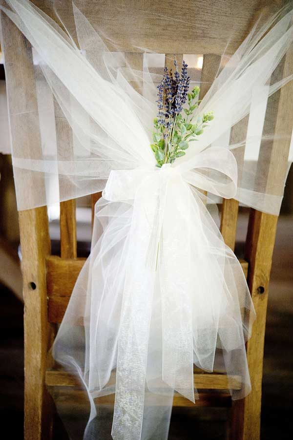 25 creative wedding decoration ideas hative lavender and tulle chairbacks tie lengths of ethereal tulle to the back of your chairs junglespirit Image collections