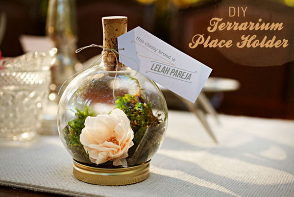 Tiny Terrarium. At wedding receptions, guests may not know where to sit. Direct guests where to sit with this identifiable tiny terrariums for decorative place card application.