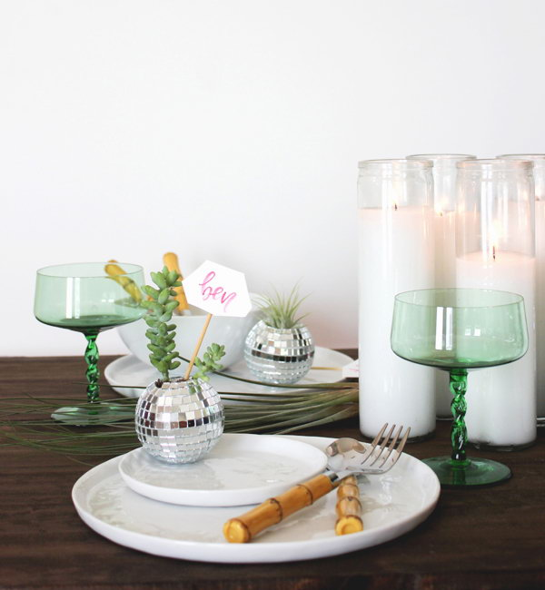 Mini Disco Ball Place Cards. Many of us are boring about ordinary place card. Replace it with these mini disco ball place cards for stunning decoration effect as well as practical seat guidance application. It's super chic to plant your succulent or place air plants inside for fresh flavor.