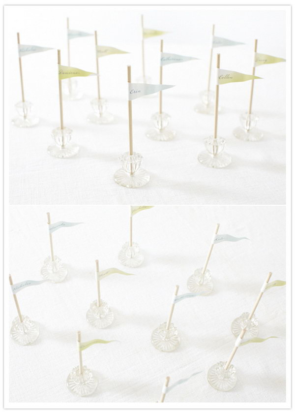 Drawer Knob Place Cards. If plants aren't your cup of tea, create this funny place holder with recycled drawer knobs for your glamorous wedding party decoration. Glue dowels together and stick into the knob. Place colorful flag tags with guests' names written.