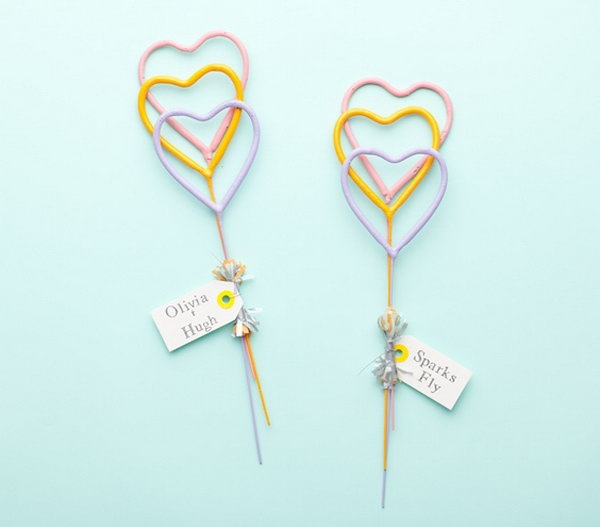 Heart-shaped Sparkles. When it comes to departure for the unforgettable wedding ceremony, distribute fireworks with these heart-shaped sparkles to enhance your elegant affair.