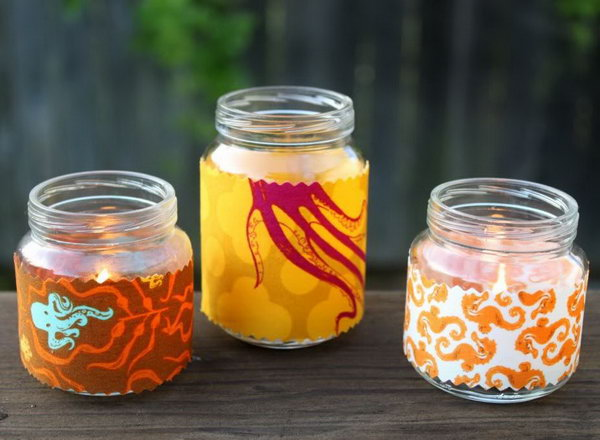 Fabric Baby Jar Votives. Transform your plain jar into an exquisite one by wrapping up the jar with beautiful patterned fabric. Place candles to finish off this adorable well refined work of art.