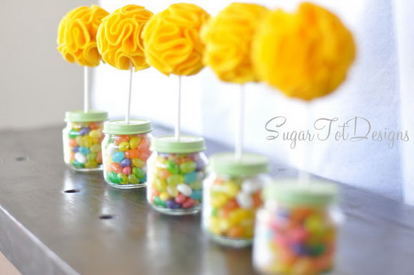 Baby Food Jar Topiary. Fill the baby food jar with colorful jelly beans, insert with a puffy flower topiary to present an exquisite outlook. These adorable things would be great centerpieces for a baby shower.
