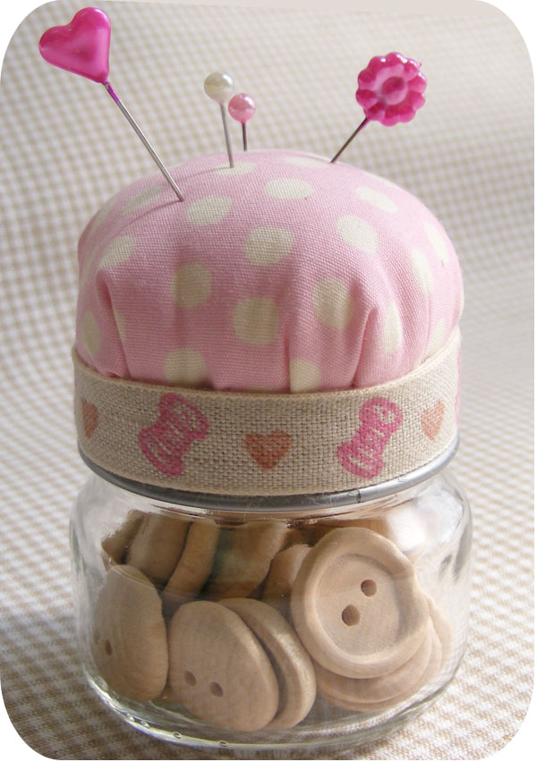 Baby Food Jar Pin Cushion. Make the pin cushion from pink fabric and fluffy pillow stuffing. Glue pincushion at the top of the jar lid and use beautiful ribbons to cover the side of the jar lid. It's fantastic to repurpose your jar in this way.