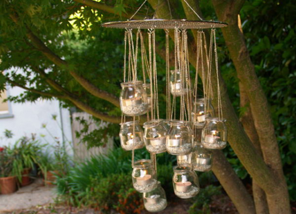 Garden Chandelier. It's super chic to add soft, eco-friendly candlelight to your garden with this beautiful chandelier made from baby food jars as well as circular cooling rack.