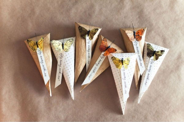 Butterfly Cady Cones. Make cone with cardstock. Fill it with candies, popcorn, rice or whatever you like, fold top, add tag and connect with butterfly in body of cone to finish off this elegant piece of art in a cheap way.