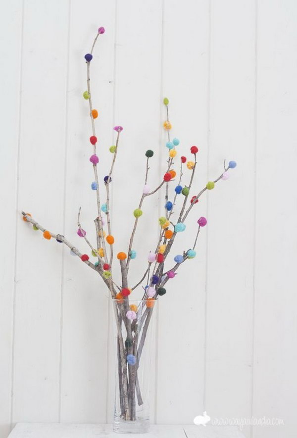 Pom pom Branch Bouquet. Use the glue gun to secure colorful pom poms on the branch in a beautiful display. Insert in a flower vase for beautiful decor with low cost.