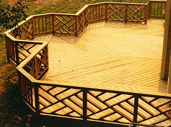 Stylish ornate wood railing. This creative idea with geometric shapes on the deck is really inspiring. The deck's layout expresses movement and flow and gives a fantastic outstanding look to this area.