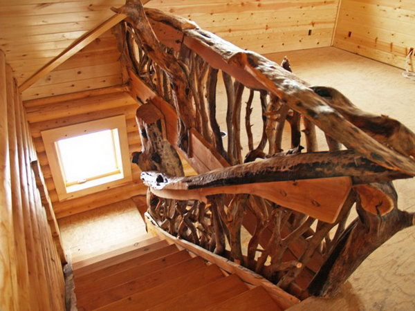 Thick, rough cut tree railing.  No matter what style you choose, nothing does more to determine your deck's look than railing. These creative thick, rough cut rails add powerful muscle to the rustic look and you can have a try on your own deck.