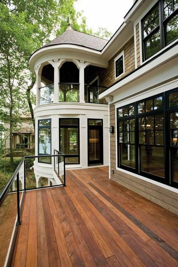Stay beautiful   Traditional deck with glass deck railing. Adorable gazebo glass system coordinates perfectly with the French doors, double hung windows and the deck.  The glasses allows unobstructed views and they are barriers against the wind.