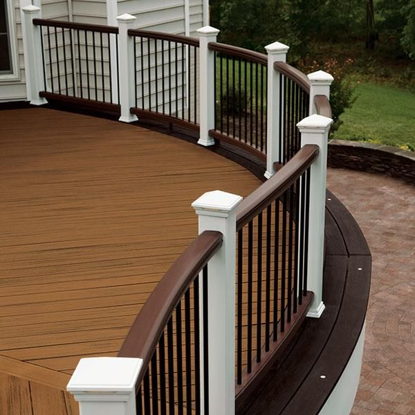 Vintage transcend deck railing. This awesome deck and deck railing with charcoal black aluminum balusters and classic white posts are really beautiful and I'm in love with them. The LED post cap lights add exquisite to this inviting space.