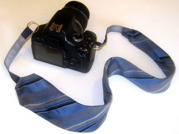 Old Necktie. Great idea. I love the idea recycling a necktie into a camera strap for Daddy very much. Learn how to do it here.