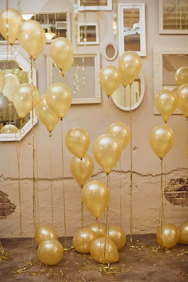 Start with the arrangement for the wedding with helium balloons tied golden ribbons and mirrors on the wall in the space. This is super divine.