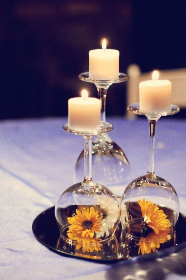 Mirror used as a table centerpiece in the wedding. This table centerpiece must be an impressive feature with mixture of candles, mirror, wine glasses and colorful flowers on the table in the wedding.